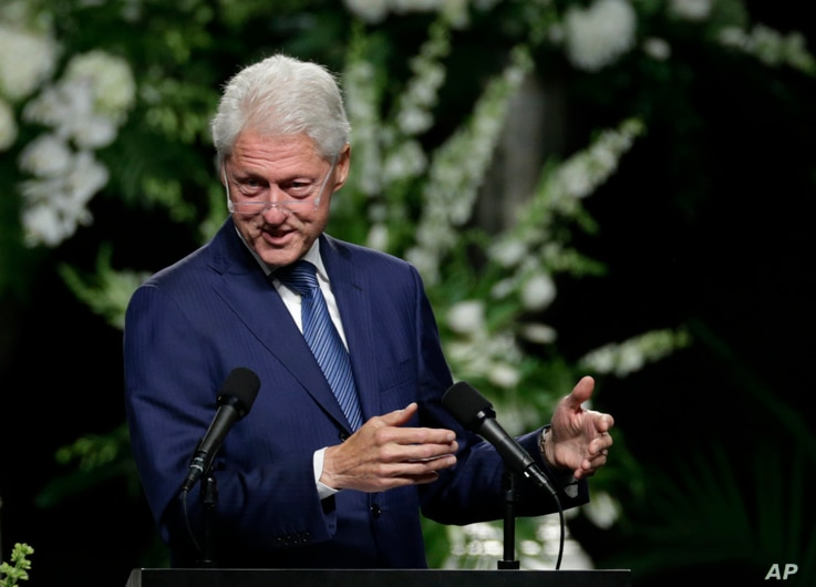 Former President Bill Clinton delivers a eulogy during Muhammad Ali's memorial service in Louisville, Ky., June 10, 2016.