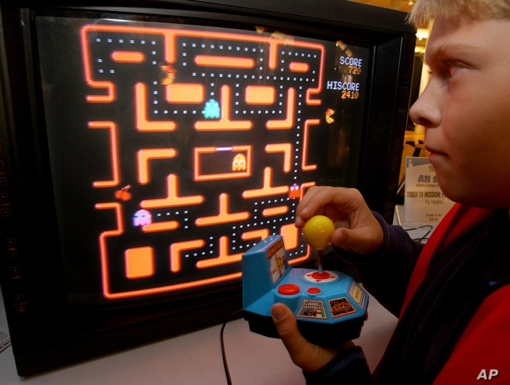 FILE - In this Oct. 5, 2004, photo, a youth tries a Ms. Pac-Man TV game in New York.