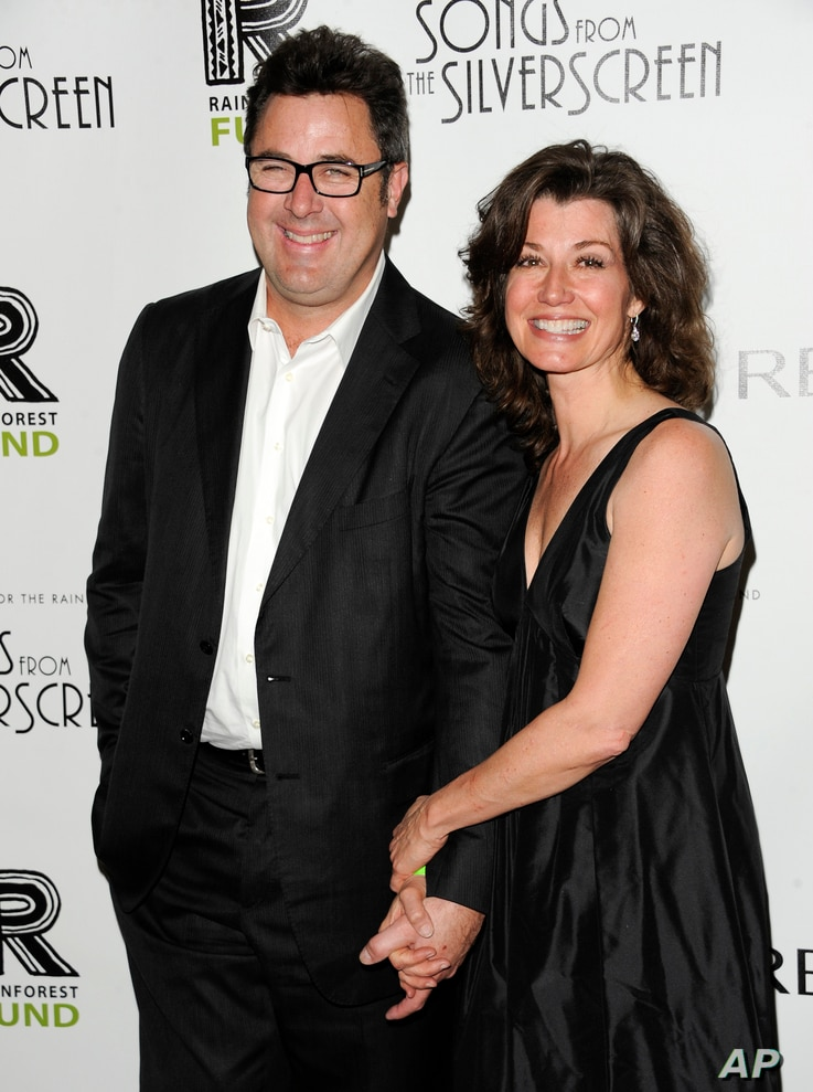 FILE - Musician Vince Gill and wife, singer Amy Grant, attend the Revlon Concert for the Rainforest Fund dinner and auction at The Pierre Hotel in New York, April 3, 2012.