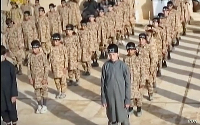 А YouTube screen grab from an Islamic State propaganda video shows child soldiers at an alleged IS training camp. Many of the children are reportedly taken from captured families and civilians living in IS-controlled areas.