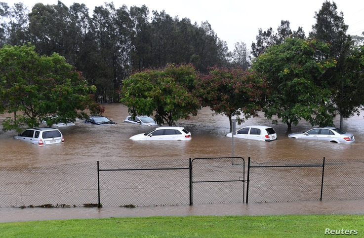 Cars sit submerged after heavy rain associated with Cyclone Debbie hit the Gold Coast suburb of Robina in Queensland, Australia, March 30, 2017.