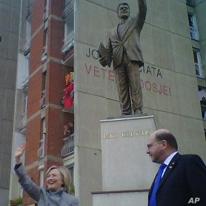 Hillary Clinton visiting the Bill Clinton statue in Pristina with US Ambassador to Kosovo Chrustopher Dell as a crowd of Kosovars cheer Clinton, 13 Oct 2010