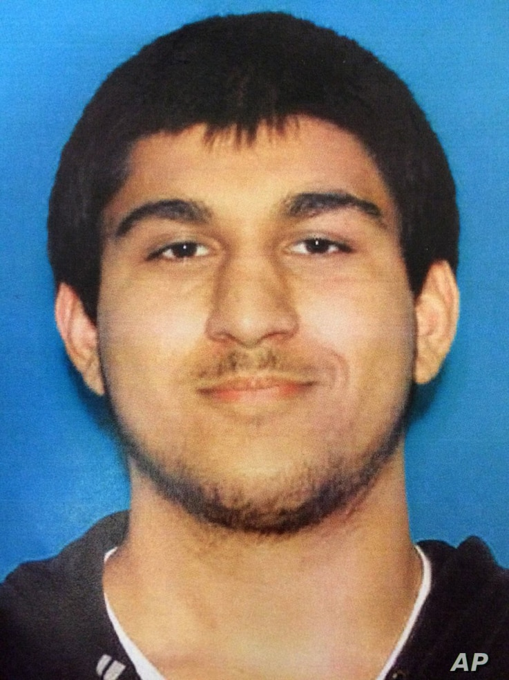 This undated Department of Licensing photo posted Sept. 24, 2016, by the Washington State Patrol on its Twitter page shows Arcan Cetin, 20, of Oak Harbor, Wash.