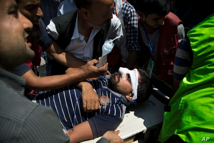 An injured Kashmiri man is brought for treatment on a stretcher at a hospital in Srinagar, Indian-controlled Kashmir, Aug. 24, 2016. Indian government forces fired shotguns and tear gas in India's portion of Kashmir to break up new protests demanding...