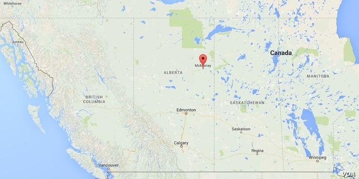 The red arrow locates Fort McMurray, Alberta, Canada.
