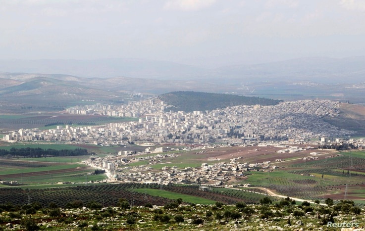 FILE - A general view shows the Kurdish city of Afrin, in Aleppo's countryside, Syria, March 18, 2015.