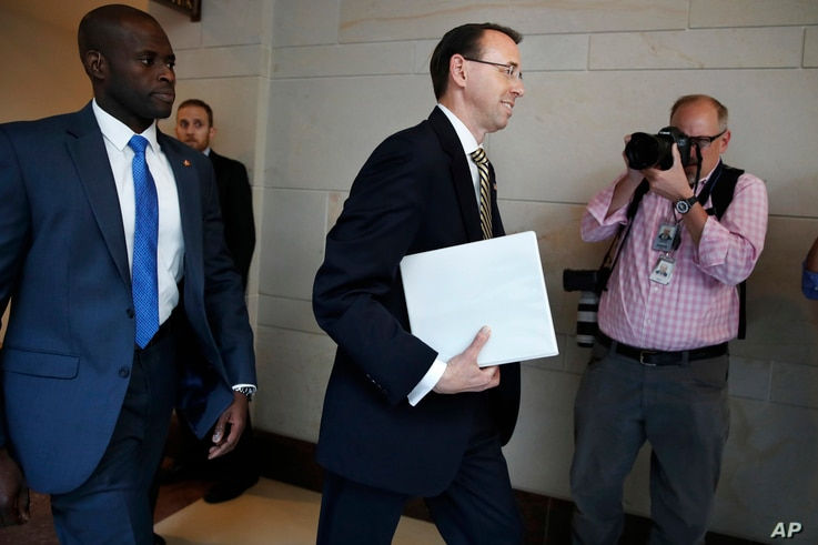 Deputy Attorney General Rod Rosenstein arrives on Capitol Hill in Washington, May 18, 2017, for a closed-door meeting with Senators a day after appointing former FBI Director Robert Mueller to oversee the investigation into possible ties between Russ...