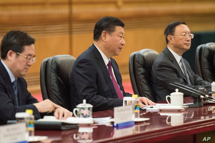 FILE - China's President Xi Jinping (C) talks with  Maldives' President Abdulla Yameen, during a meeting at the Great Hall of the People in Beijing, Dec. 7, 2017.