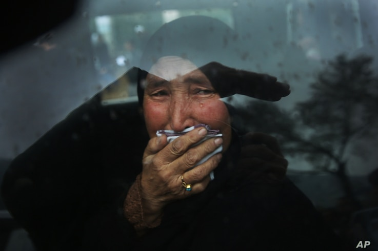 A Hazara tribeswoman cries in a car as thousands march through the Afghan capital of Kabul on Nov. 11, 2015, carrying the coffins of seven ethnic Hazaras who were allegedly killed by the Taliban.