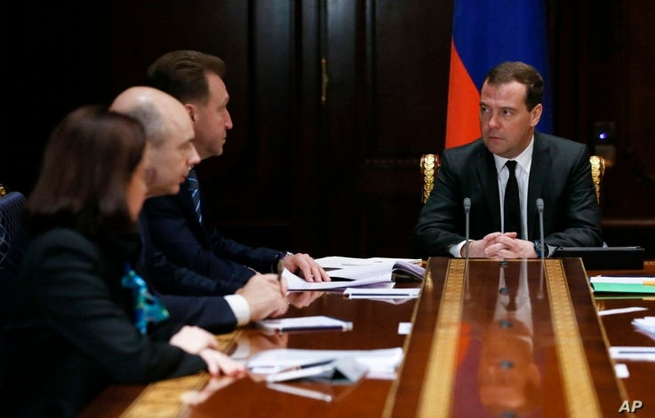 Russian Prime Minister Dmitry Medvedev chairs a government meeting in the Gorki residence outside Moscow on ways to shore up the plummeting ruble, Dec. 16, 2014.