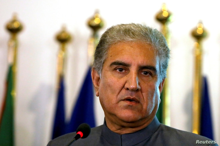 Pakistan's new Foreign Minister Shah Mehmood Qureshi listens during a news conference at the Foreign Ministry in Islamabad, Pakistan, Aug. 20, 2018.