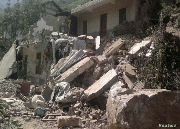 Two shallow 5.6 magnitude earthquakes hit southwestern China on Friday, killing at least 50 people and forcing tens of thousands of people from damaged buildings, Sept. 7, 2012.