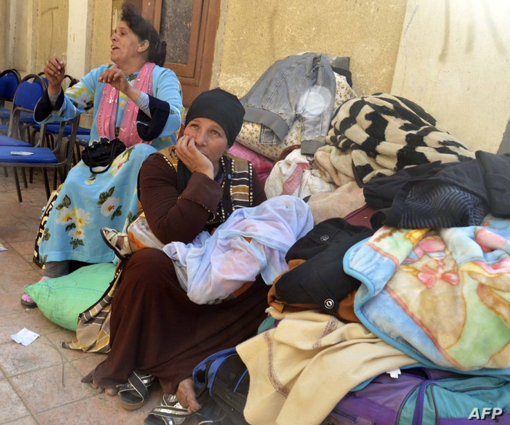 Egyptian Coptic Christians sit in the courtyard of the Evangelical Church in the Suez Canal city of Ismailiya, Feb. 24, 2017, upon arriving to take refuge from Islamic State (IS) group jihadists.
