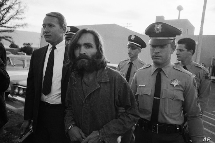"""Charles M. Manson, leader of a hippie cult accused of multiple murders, leaves a Los Angeles courtroom, Dec. 22, 1969 after telling a judge """"lies have been told"""" about him."""