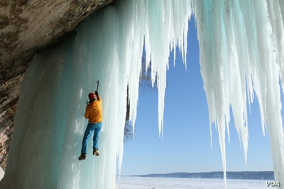 Conrad Anker climbs frozen waterfalls in Pictured Rocks National Lakeshore in Michigan. (Photo by Barbara MacGillivray, Courtesy of MacGillivray Freeman Films)