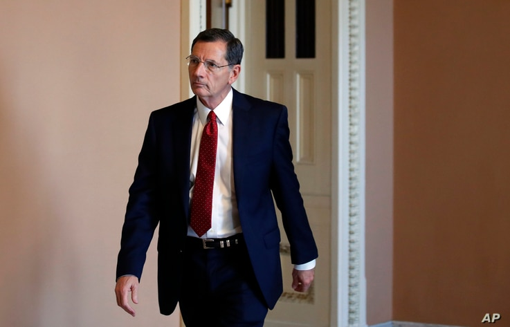 Sen. John Barrasso, R-Wyo., heads to the Senate floor, on Capitol Hill, Oct. 3, 2018 in Washington.
