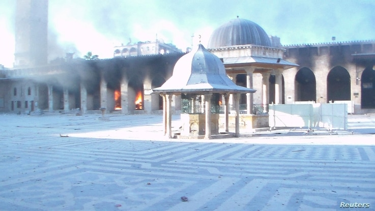 Fire burns after shelling at the Great Mosque of Aleppo, Oct. 13, 2012.