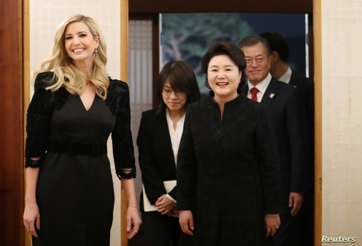 South Korean President Moon Jae-In, his wife Kim Jung-sook and Ivanka Trump arrive for their dinner at the Presidential Blue House in Seoul, South Korea, Feb. 23, 2018.