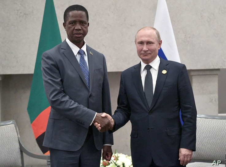 President Edgar Chagwa Lungu of Zambia, left, and Russia's President Vladimir Putin pose for a photo at the BRICS summit in Johannesburg, South Africa, July 26, 2018.