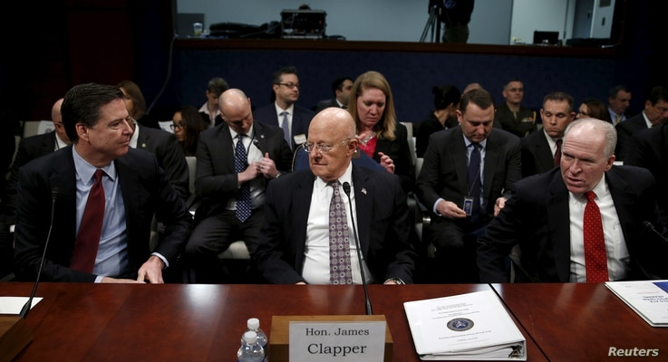 Then-FBI Director James Comey (L), then-U.S. Director of National Intelligence James Clapper (C) and then-CIA Director John Brennan (R) take their seats to testify at a hearing on Capitol Hill in Washington, Feb. 25, 2016. President Donald Trump has ...