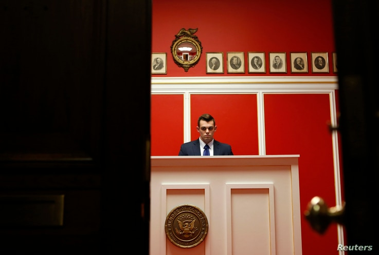 FILE -  A staff member works at the office of Representative Aaron Schock on Capitol Hill in Washington, March 17, 2015. Schock resigned following questions about his use of taxpayer dollars.