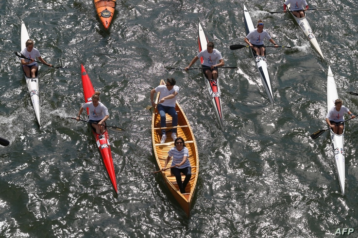 Paris Mayor Anne Hidalgo (C, bottom) sails with the co-president of the Paris bid for the 2024 Olympics Tony Estanguet (C, up) on the Seine river in Paris, June 23, 2017, in a bid to promote the candidacy of the city of Paris for the Summer Olympics ...