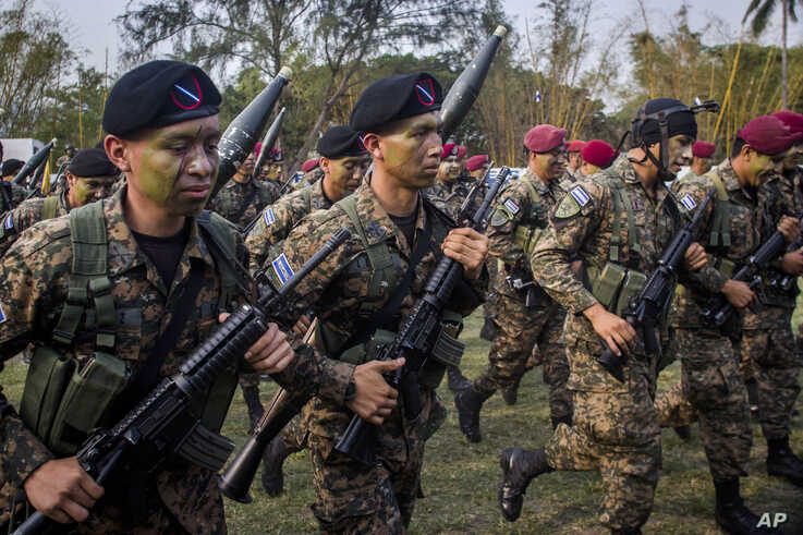 FILE - El Salvador army special forces march during a presentation to the press as part of a stepped-up phase in the government's fight against gangs in San Salvador, El Salvador, April, 20, 2016. The government of El Salvador deployed 1,000 soldiers