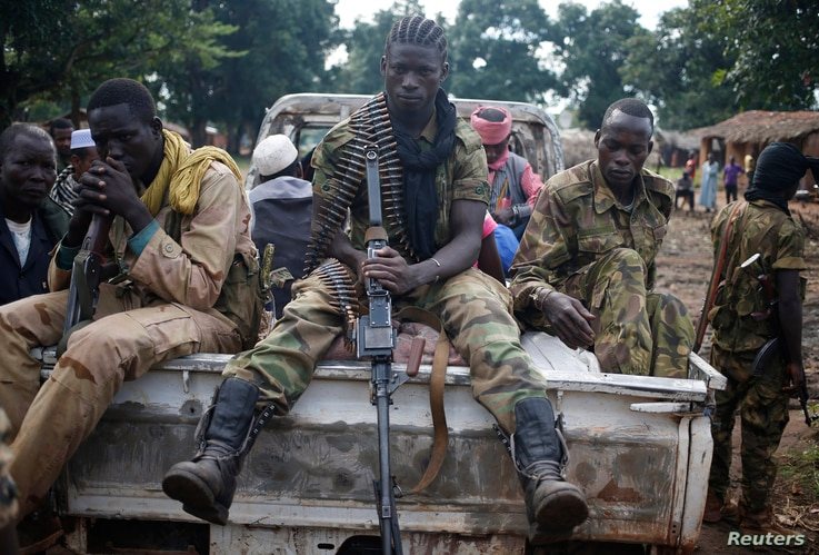 FILE - Seleka fighters sit on a pick-up truck in the town of Goya, Central African Republic, June 11, 2014.