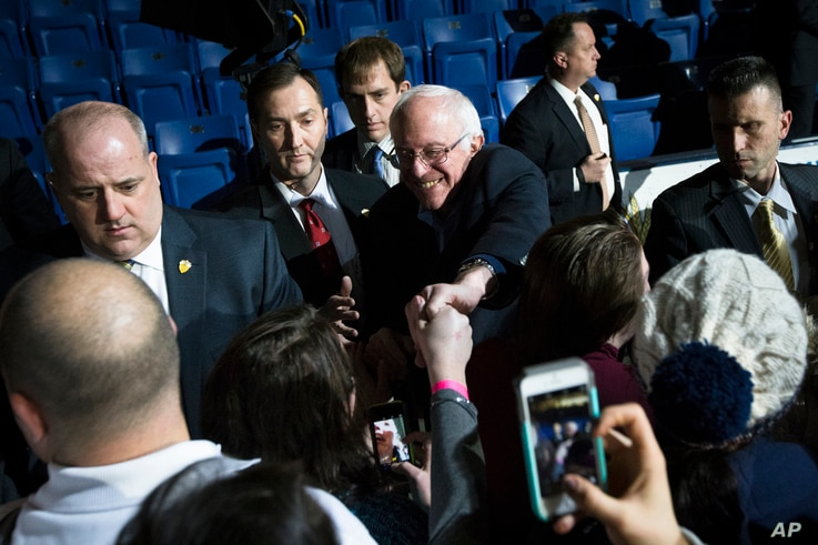 Democratic presidential candidate Sen. Bernie Sanders shakes hands with attendees during a campaign stop at the University of New Hampshire Whittemore Center Arena in Durham, N.H., Feb. 8, 2016.