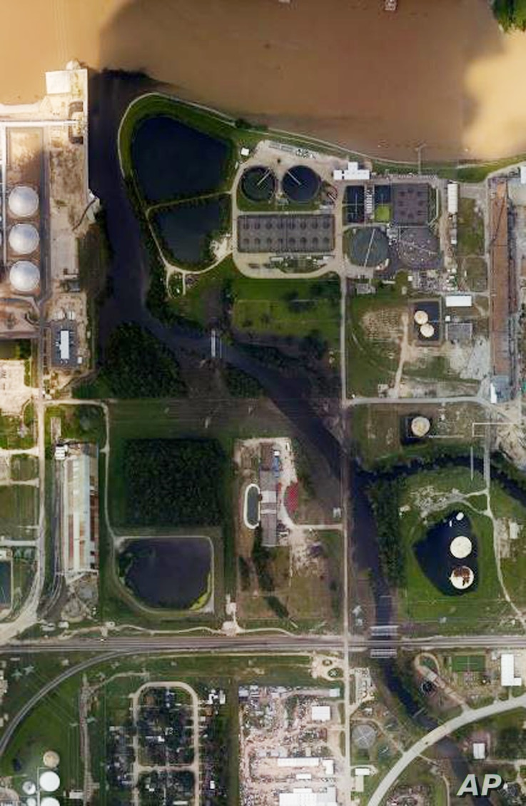 This aerial photo from the National Oceanic and Atmospheric Administration shows floodwaters surrounding the U.S. Oil Recovery Superfund site outside Houston flowing into the San Jacinto River. The Environmental Protection Agency says it has found no...