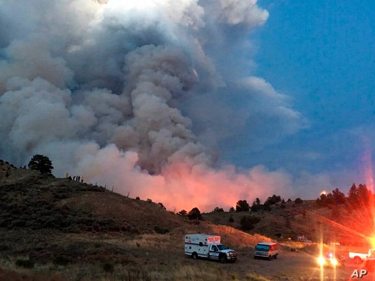 This photo provided by the Department of Homeland Security Emergency Management shows a wildfire burning near Forbes Park in southern Colorado, June 28, 2018.