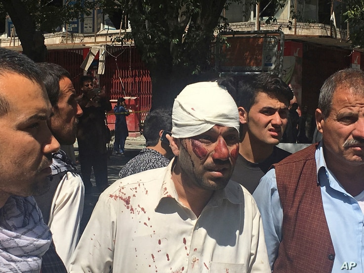 An injured man is seen after an explosion in Kabul, Afghanistan, May 31, 2017. A U.N. report released Monday, July 17, 2017, said Afghanistan's protracted war killed a record number of civilians during the first six months of this year.