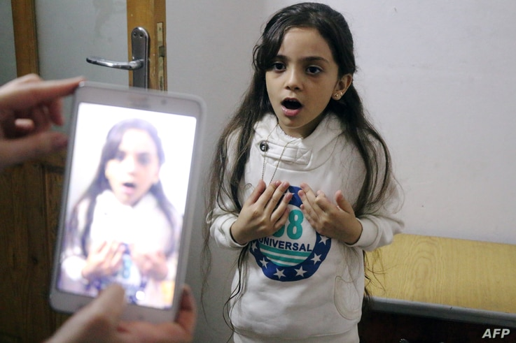 Syrian Bana al-Abed is filmed by her mother as they prepare to post on Twitter in English about life in the besieged eastern districts of Syria's Aleppo, Oct. 12, 2016.