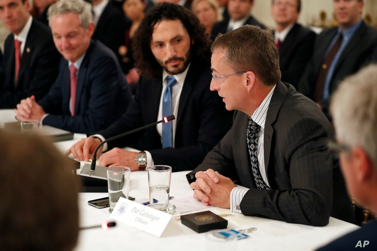 Pat Gelsinger, Chief Executive Officer of VMware, right, speaks during an American Technology Council roundtable in the State Dinning Room of the White House, June 19, 2017, in Washington.