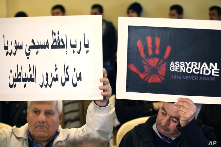 Assyrians citizens hold placards during a sit-in for abducted Christians in Syria and Iraq, at a church in Sabtiyesh area east Beirut, Lebanon, Feb. 26, 2015.