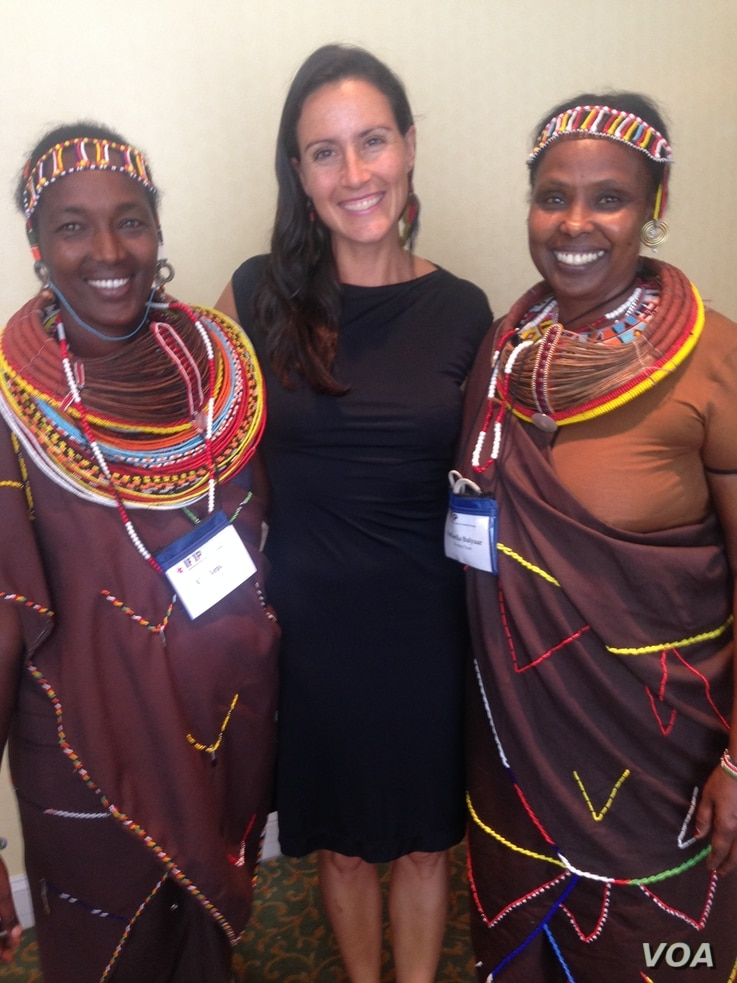 Pearl Gottschalk (C) of Lush Cosmetics, an eco-friendly corporate funder, poses with two women from Kenya's Kivulini Trust, at the World Summit on Indigenous Philanthropy in New York Oct. 2, 2014. (Courtesy - Pearl Gottschalk)