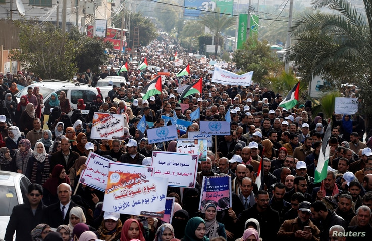 Employees of United Nations Relief and Works Agency (UNRWA) take part in a protest against a U.S. decision to cut aid, in Gaza City, Jan. 29, 2018.