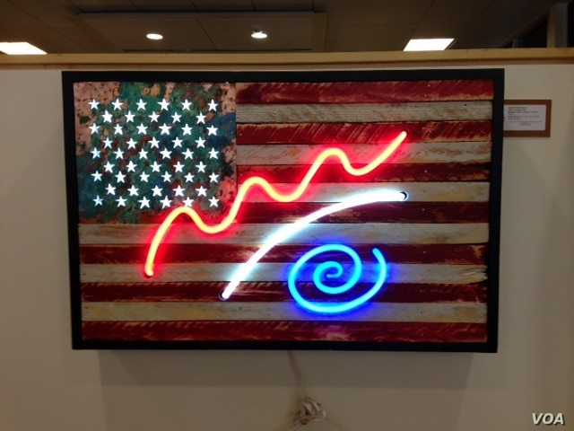 American Flag by Philip Harzard (J. Taboh/VOA)