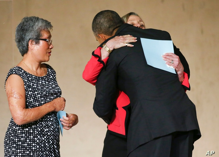 President Barack Obama greets Alson Crowther and Ling Young during the dedication ceremony at the National September 11 Memorial Museum in New York on Thursday, May 15, 2014. (AP Photo/The New York Times,  Chang W. Lee, Pool)
