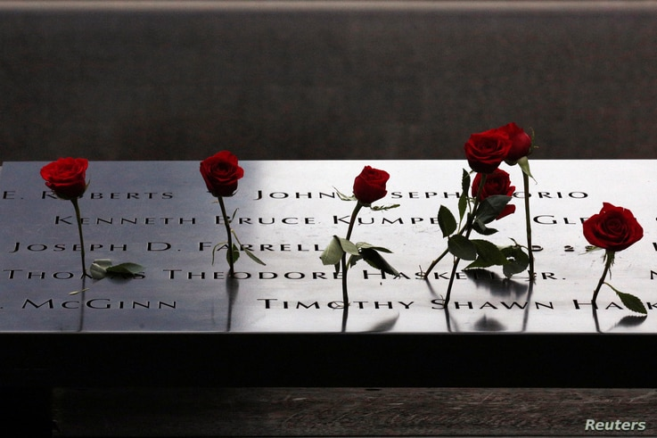 Roses are placed on names on the memorial during the ceremony marking the 15th anniversary of the attacks on the World Trade Center at The National September 11 Memorial and Museum in Lower Manhattan in New York City, Sept. 11, 2016.