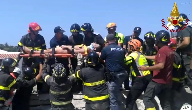Eleven-year-old Ciro is carried on a stretcher after being rescued by Italian firefighters from the rubble of a collapsed building in Casamicciola, on the island of Ischia, near Naples, Italy, Aug. 22, 2017, a day after a 4.0-magnitude quake hit the