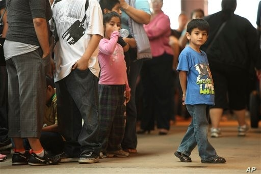 Children stand in line with some of the thousands of young immigrants at Chicago's Navy Pier on Aug. 15, 2012