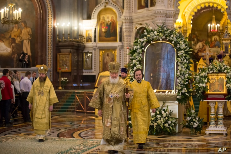 Russian Orthodox Patriarch Kirill, center, conducts a service in front of the the icon Mother of God Reigning, at second right, at the Christ the Savior Cathedral in Moscow, Russia, Feb. 19, 2017. The requiem was in memory of the victims of the faith...