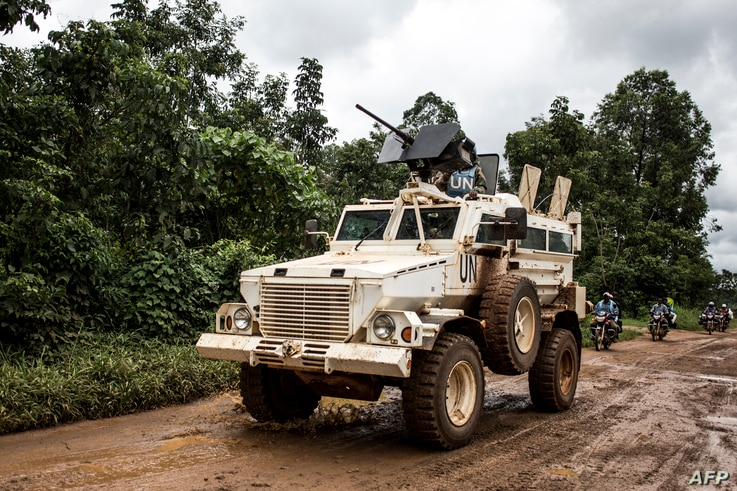 A military truck of the United Nations Organisation and Stabilisation Mission in the Democratic Republic of the Congo patrols on the road linking Beni to Mangina on Aug. 23, 2018 in Beni, in the DRC's North Kivu province.