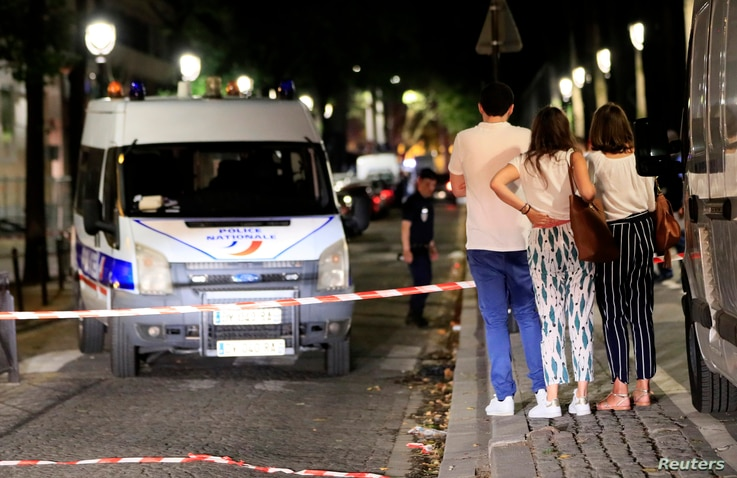 Police secures the area after seven people were wounded in knife attack in downtown Paris, Sept. 10, 2018.
