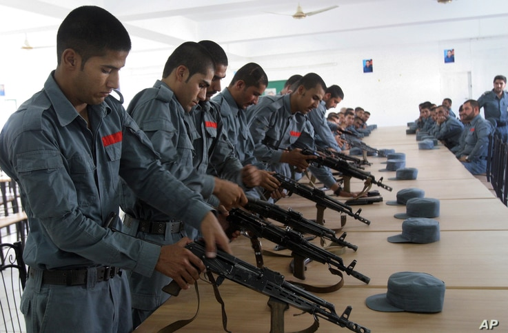 FILE - Afghan security forces practice handling their weapons in Lashkargah, capital of the southern Helmand province, July 23, 2016. More than 900 reportedly were killed last month alone in heavy fighting against Taliban insurgents.