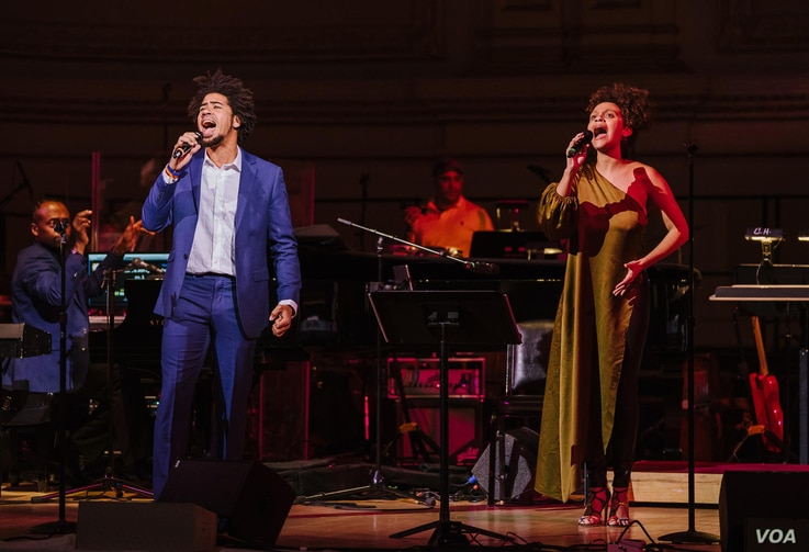 """Rob performs his original song """"Testify"""" with teaching artist Sarah Elizabeth Charles in concert at Carnegie Hall, March 11, 2018 (Photo by Fadi Kheir)"""