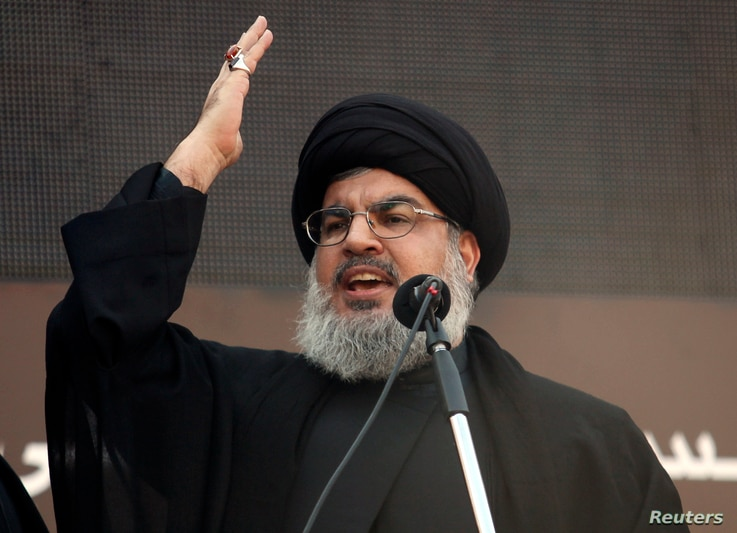 Lebanon's Hezbollah leader Sayyed Hassan Nasrallah addresses his supporters during a religious procession to mark Ashura in Beirut's suburbs, Nov. 14, 2013.