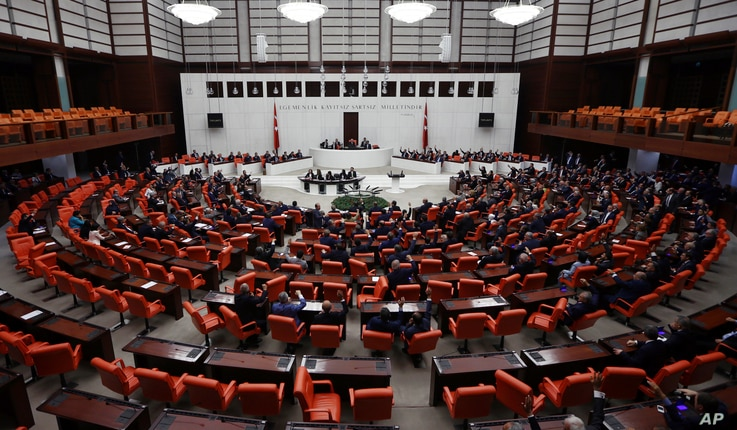 Members of the parliament vote during an extraordinary session in Ankara, Turkey, Sept. 23, 2017.
