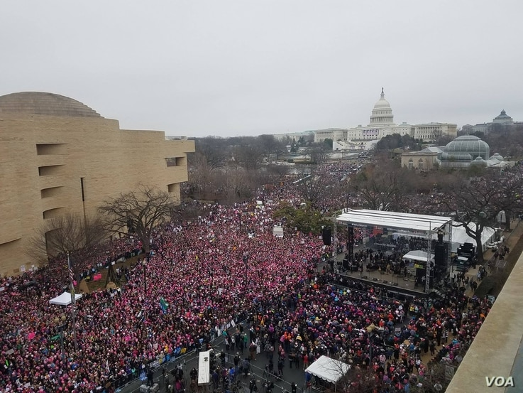 Women's March protesters span across the Mall in Washington D.C., Jan 21. 2017.  Hundreds of thousands are attending the protest against the Trump presidency. (Photo: N. Papadogiannakis / VOA)